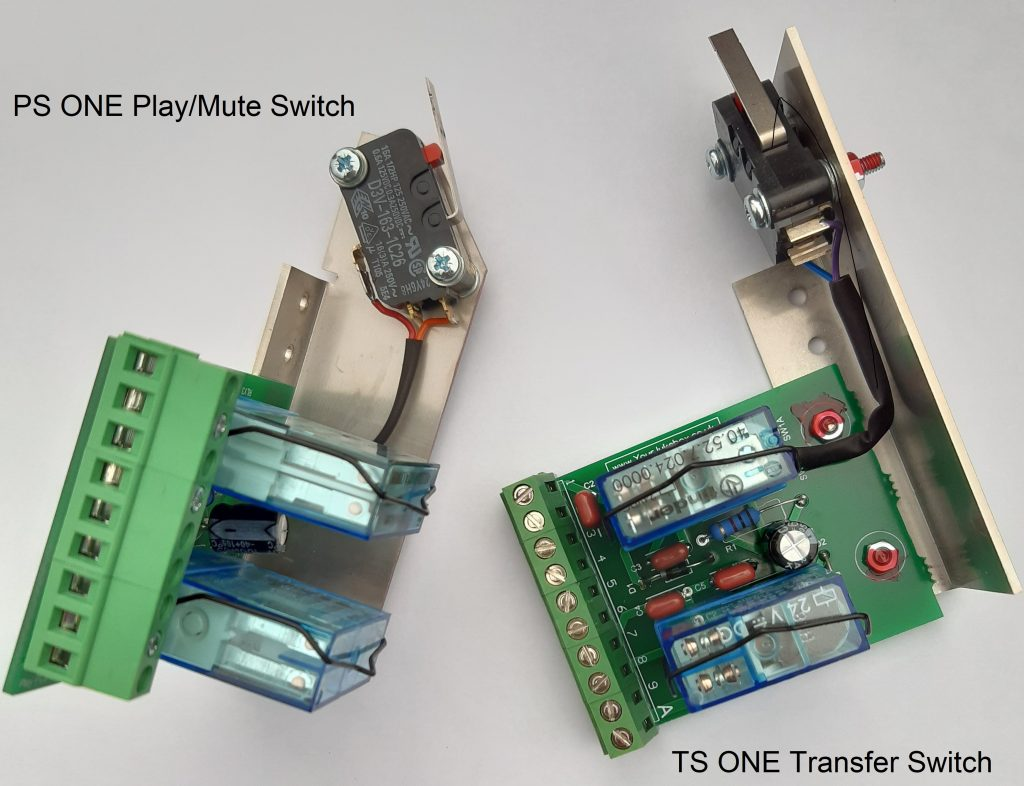 Photograph showing the PS ONE Play/Mute switch and the TS ONE Transfer Switch